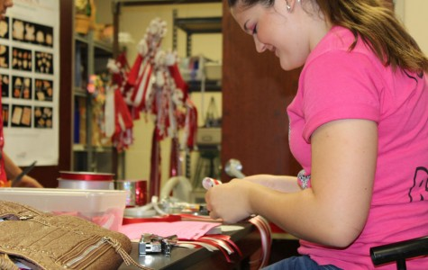 Floral Design Classes Produce Homecoming Mums and Garters