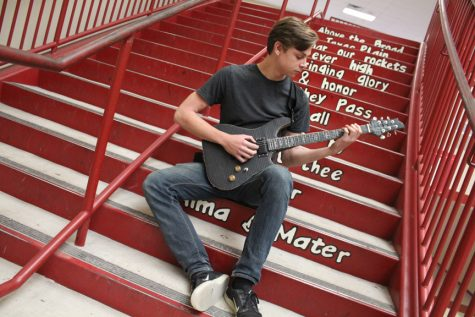 Junior Justin Kahl creates working guitar out of cardboard