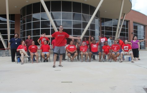 The Judson Administration Team does the Ice Bucket Challenge in the courtyard of Judson High School. The Ice Bucket Challenge has raised $94 million dollars.