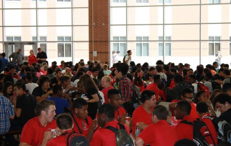 Students eat in the large cafeteria of Judson High School. The campus must have 4 lunches to accommodate all of the students.