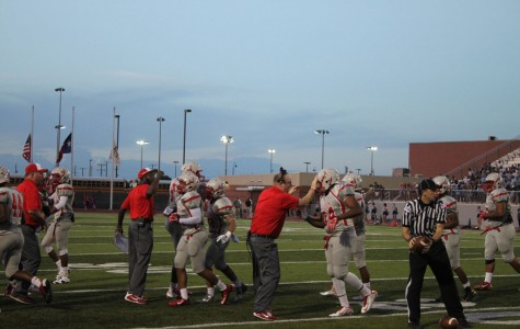 Coach McAuliffee (center) celebrates with his players after a run against Pflugerville.