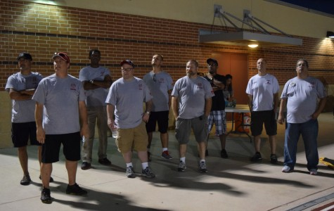 The Load Crew prepares to set up and help out the band students during home football game. The Load Crew is a group of volunteer parents who help the band move their instruments and set up for their performances.