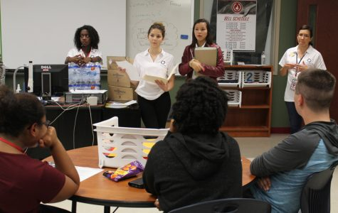 DECA, NHS sponsoring canned food drive for Haiti victims