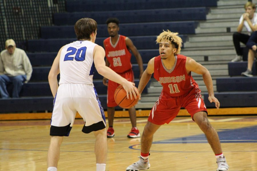 Boys basketball first district game heads into overtime
