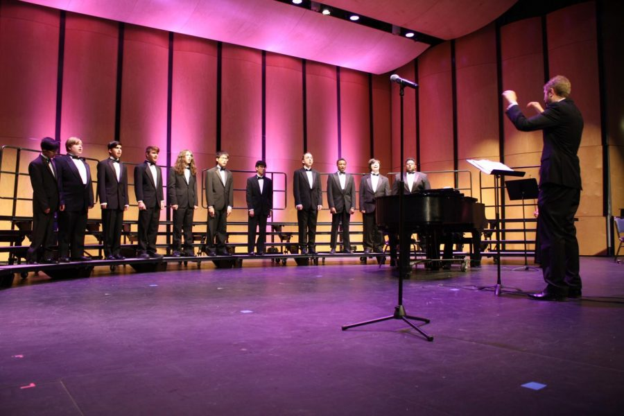 Mr. David Short conducts Brothers Ensemble during the choir concert. This is the last concert of the year for choir.