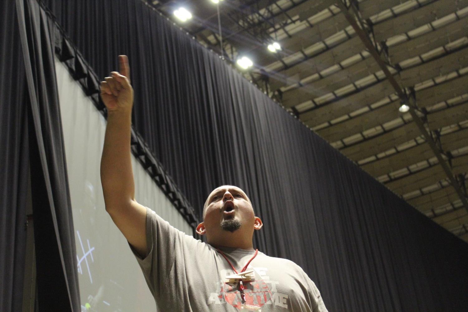 Principal Jesus Hernandez yells out at the Freeman Coliseum during the crowd. This year is Hernandez's eighth year as principal.