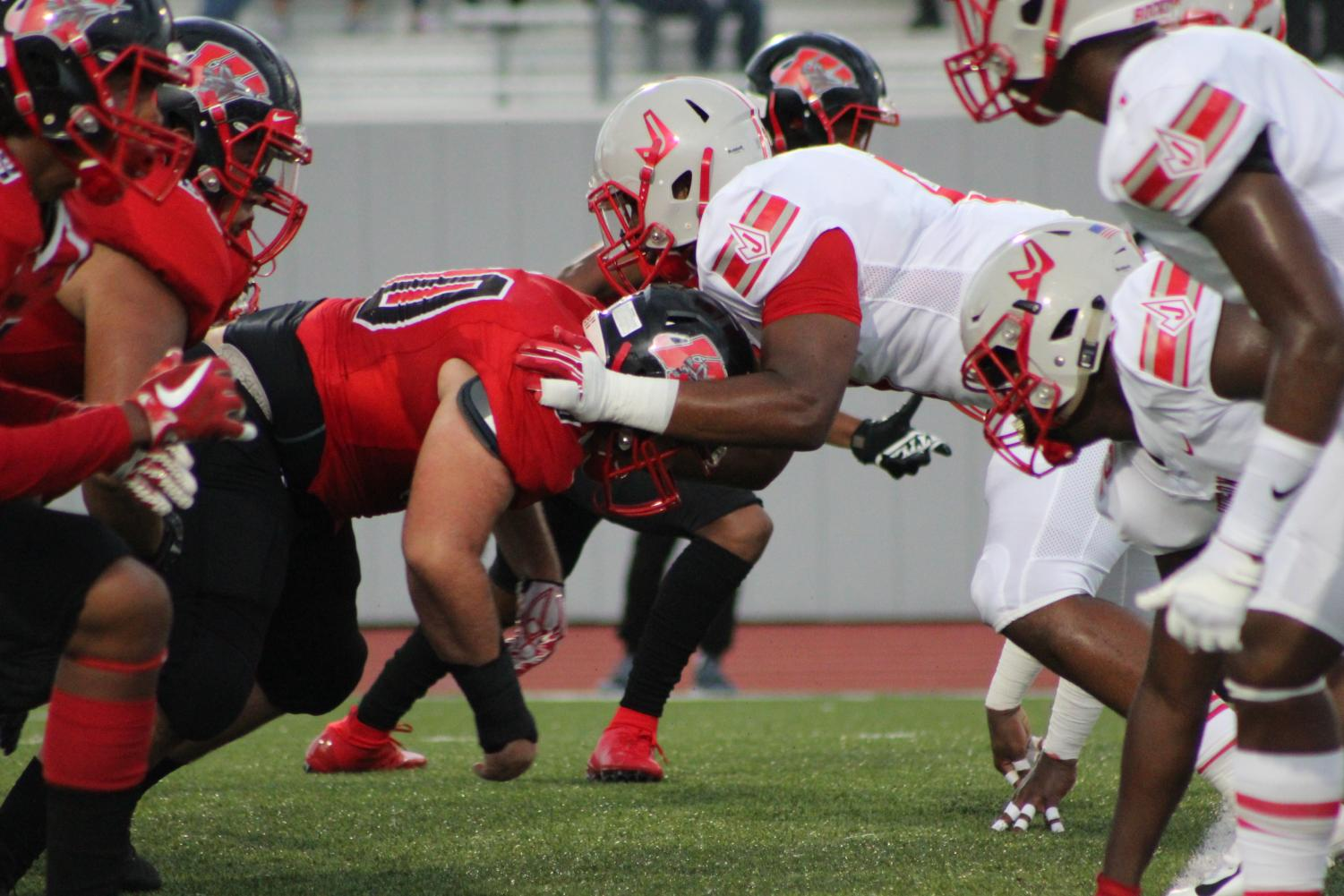 Judson defensive tackle attempts to move past the offensive line in attempts for a quick sack/tackle. Rockets win 35-27 at the annual Hammer Bowl game.