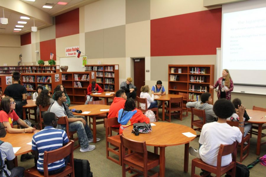 Jennifer Ruth explaining the rules of the Japanese Culture and Anime Club in the library. Ruth has been sponsoring the Japanese Culture and Anime Club since 2012.