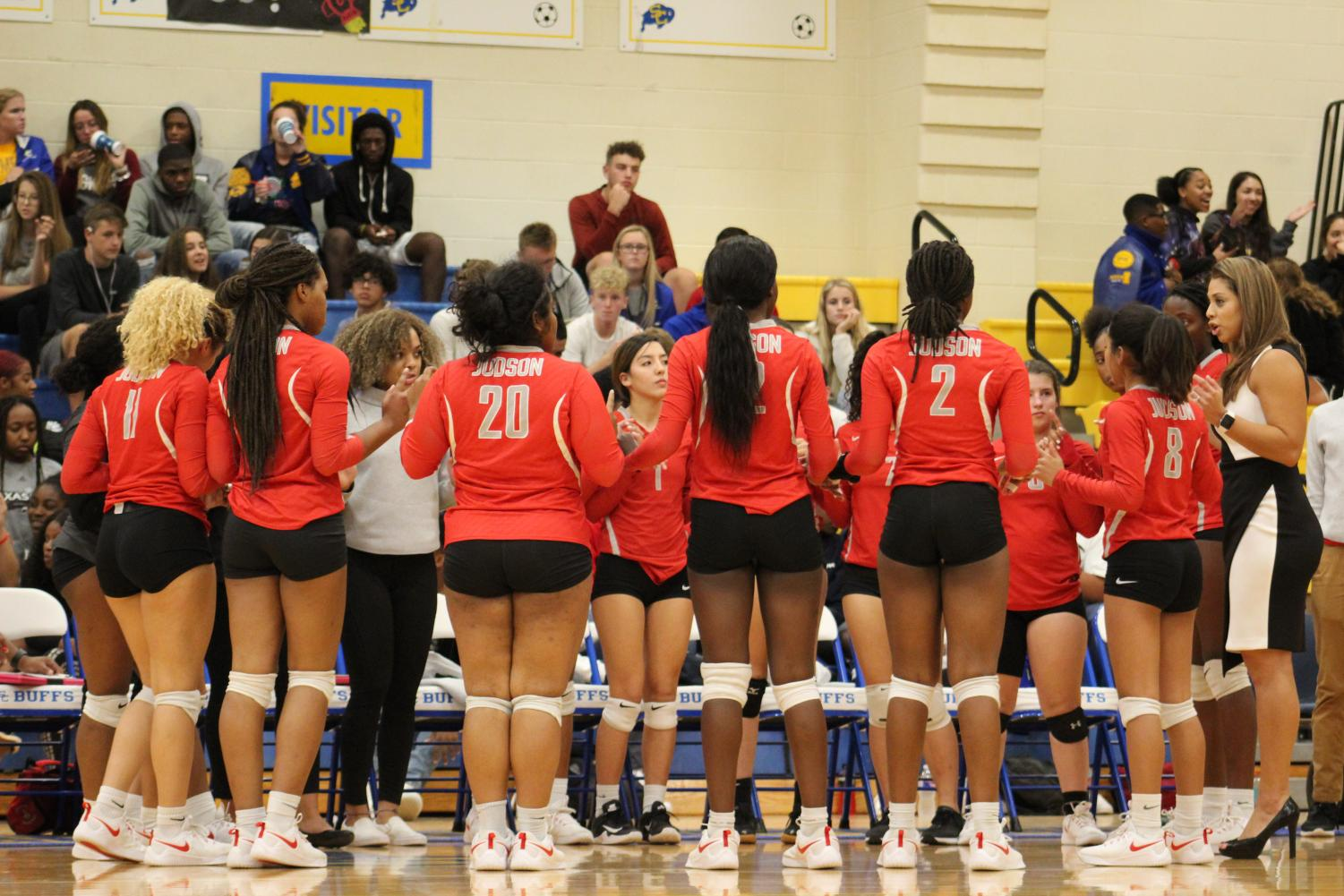 Volleyball Coach De Lo Santos motivates the Lady Rockets during a timeout. The Rockets fell to the Clemens Buffaloes 0-3.
