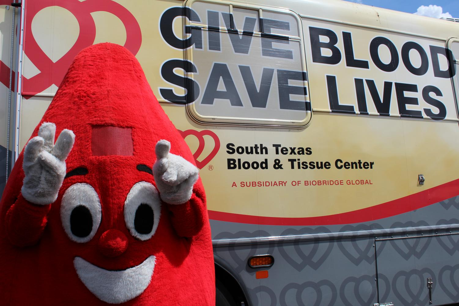 The blood drive mascot stands by the blood mobile, to encourage donating blood. Every year, Judson holds the blood drive through three different organizations throughout the year and has been doing this for 25 plus years.