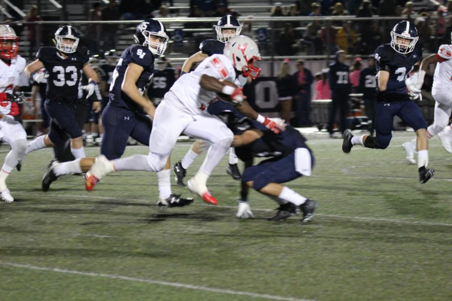 Senior Sincere McCormick shakes a Ranger defenders tackle rushing into the end zone for another touchdown. Rockets win 28-0 away at Ranger Stadium.