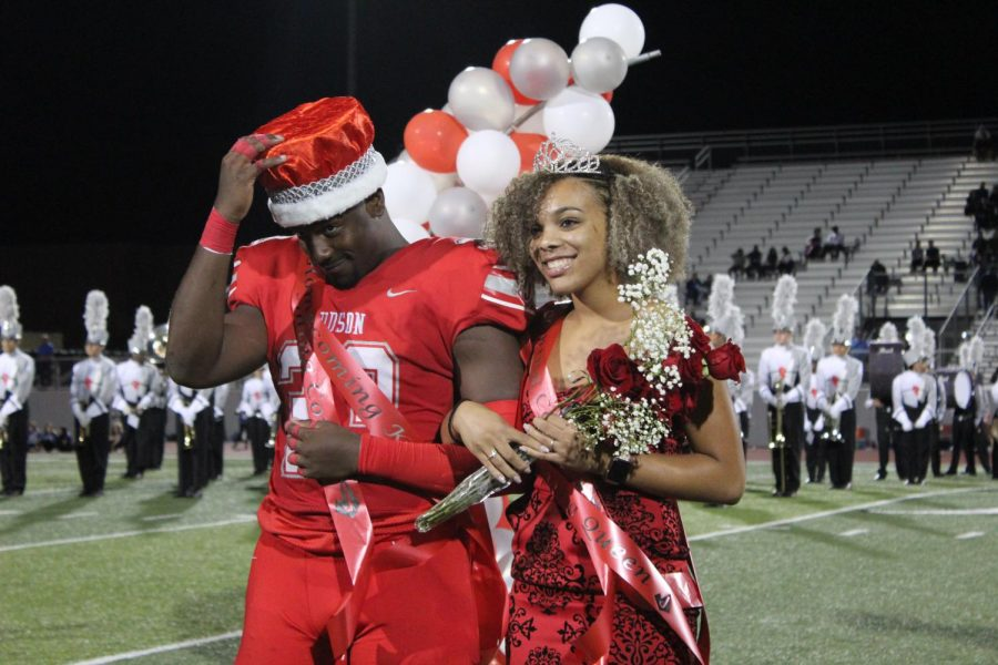 Seniors Samari Crane and Zoe Lewis posing for the Homecoming King and Queen picture. Crane and Lewis were crowned Homecoming King and Queen during the football game against New Braunfels at D.W. Rutledge Stadium.