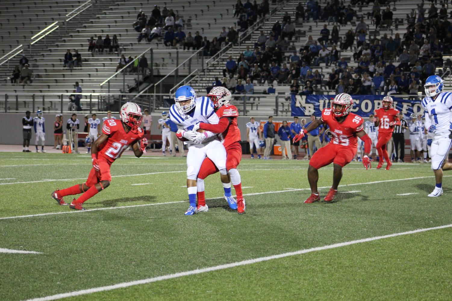 Judson defenders tries to bring down a New Braunfels receiver. Rockets capped the night off with a 37-11 win.