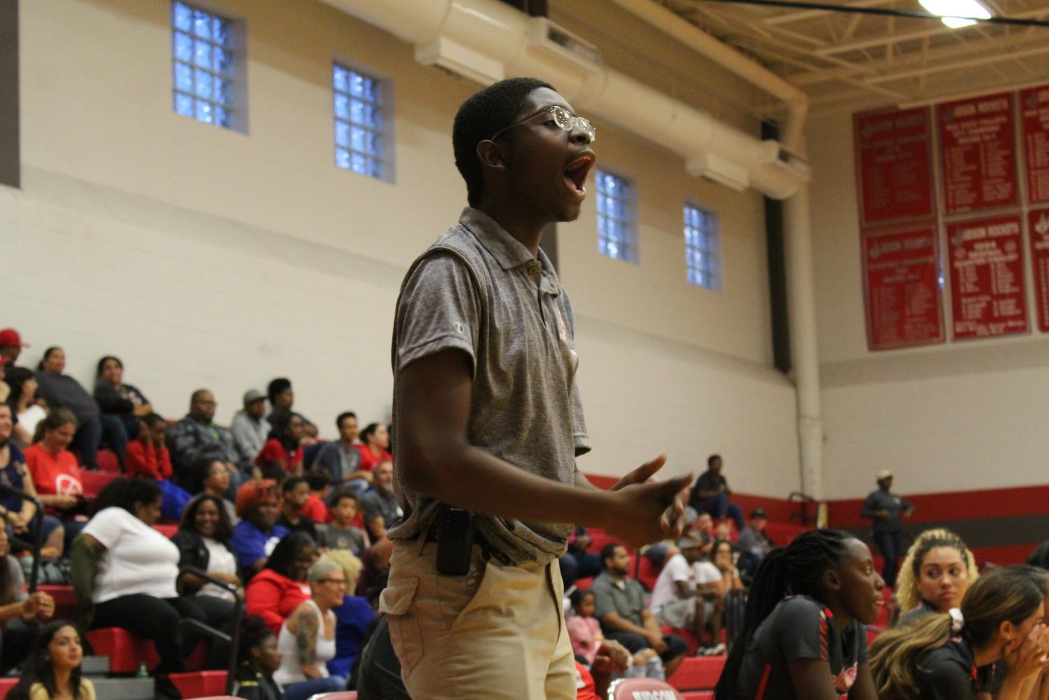 Junior athletic trainer Brandey Ivey loudly supports the volleyball team during the Lady Rockets volleyball game. Ivey is also a trainer for the softball team.