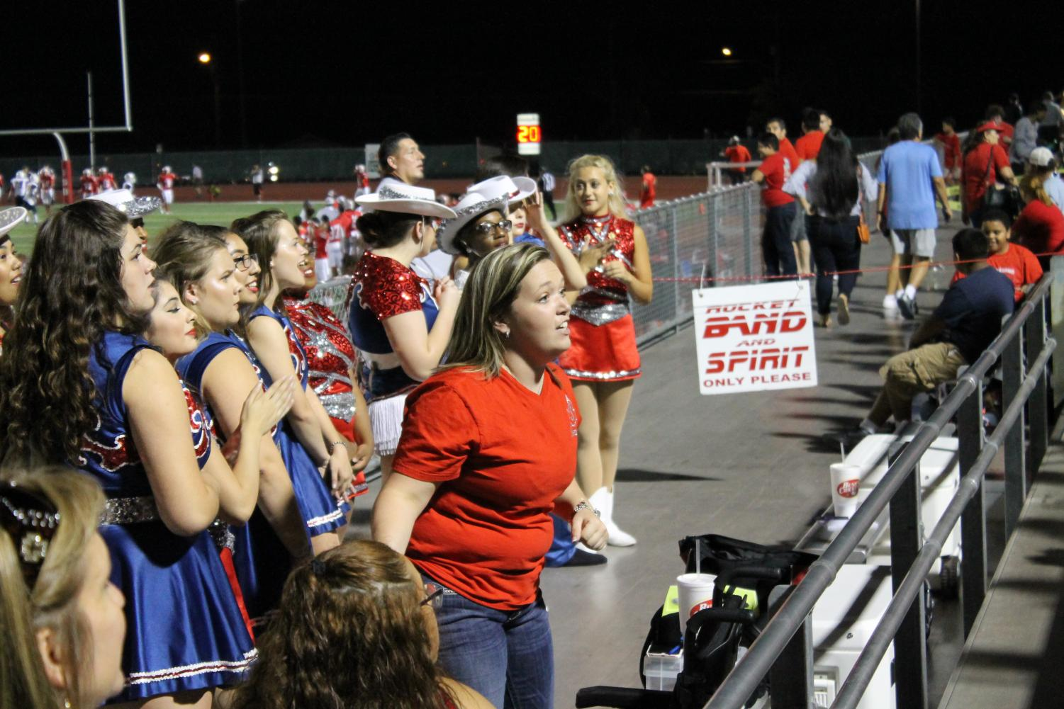 Ms. Lauryn McCarthy coaches her dancers during a football game at D.W. Rutledge Stadium. This is her second year as director of the organization.