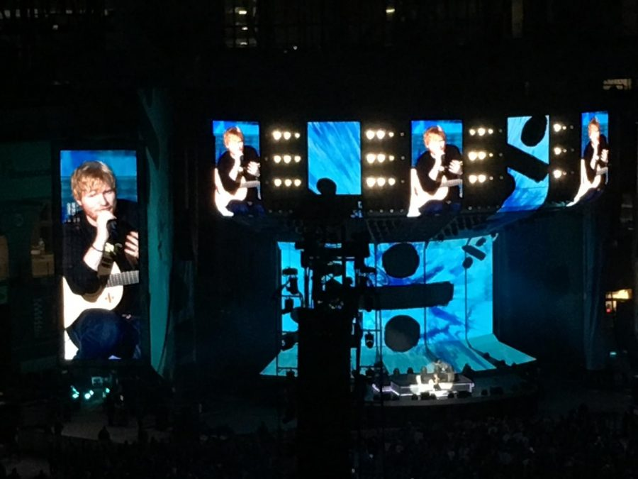 The Fuel's Alexandra Villanueva takes a picture from her seat during the Ed Sheeran concert. The concert took place in Houston's Minute Maid Park, part of his stadium tour.