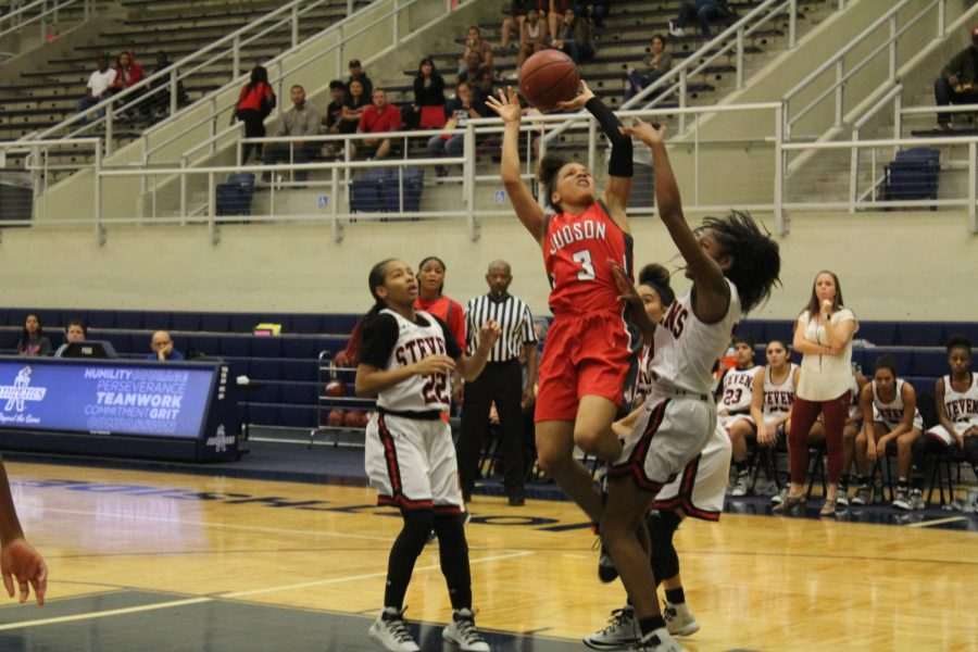 Senior+Corina+Carter+drives+in+for+a+layup+against+the+tough+Stevens+Falcons+defense.+The+Lady+Rockets+rolled+past+the+Falcons%2C+70-20.