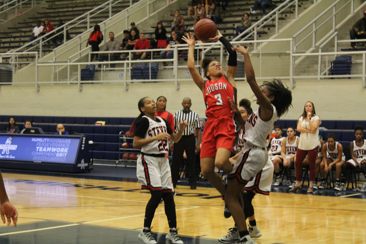 Senior Corina Carter drives in for a layup against the tough Stevens Falcons defense. The Lady Rockets rolled past the Falcons, 70-20.