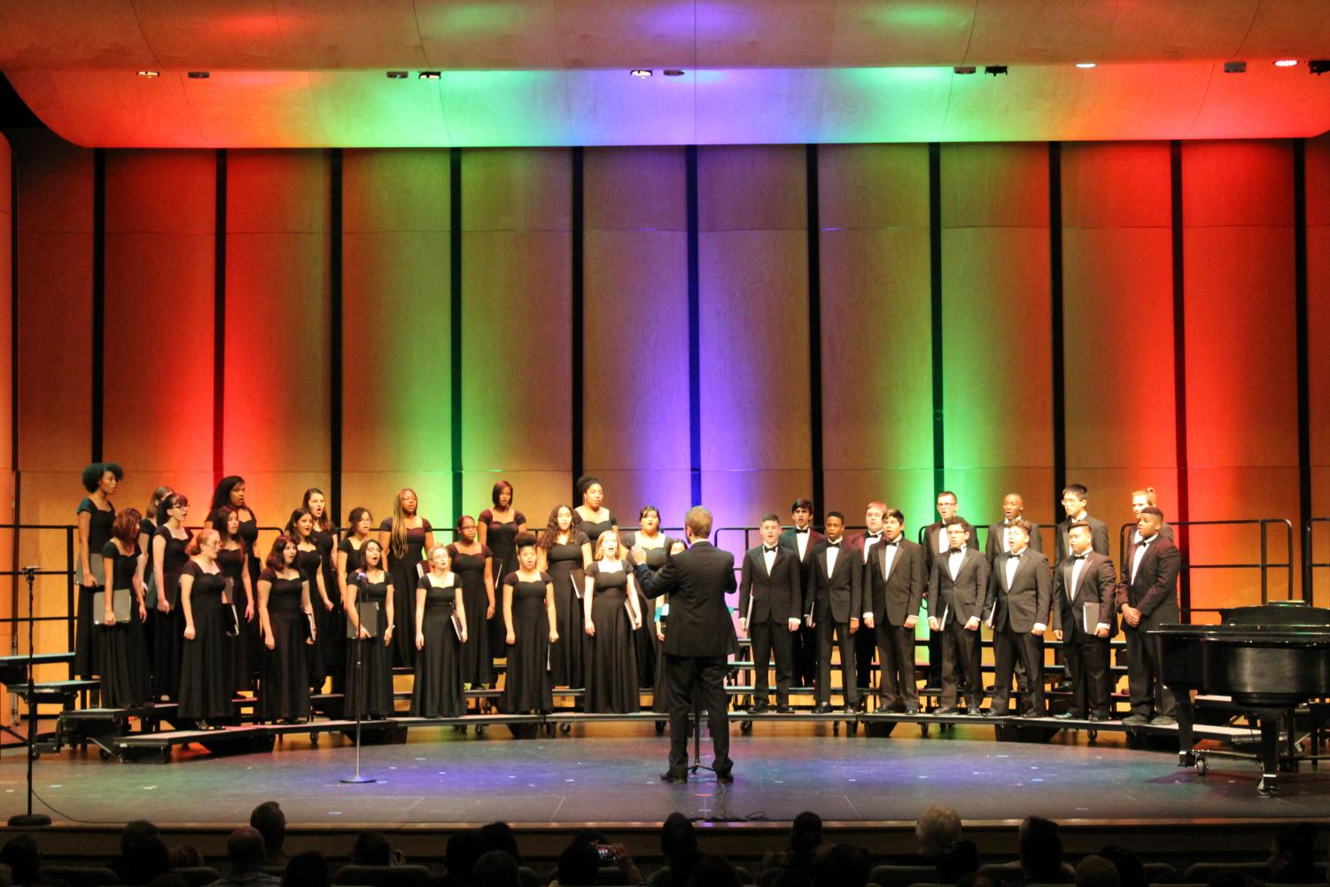 Choir director David Short leads the chorale during their annual winter concert. After the concert, the choir will begin preparing for UIL.