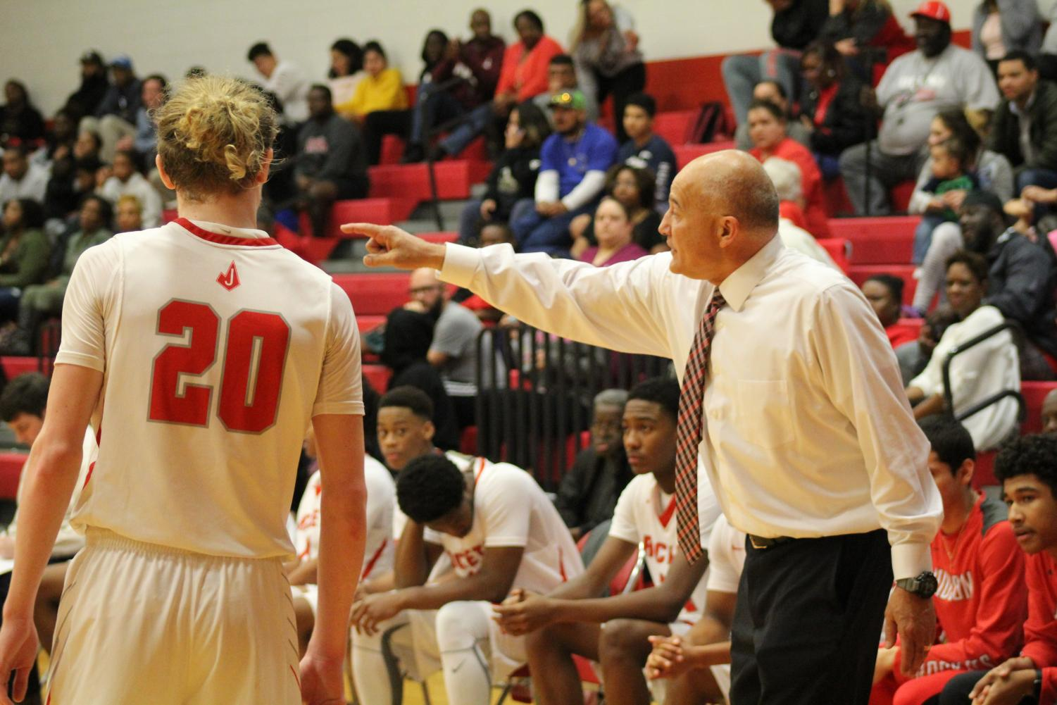 Head coach Victor Lopez coaches senior Thomas Baird. The men lost to Steele 69-76.