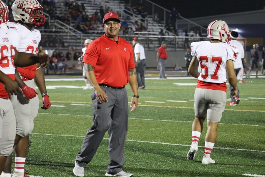 Coach Charlie Smith works with the defensive players during the San Benito game. Smith is an art teacher and is also a coach for football and baseball.