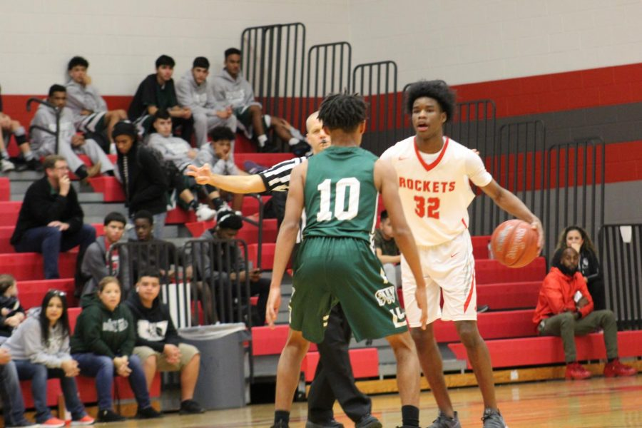 Senior Adrian Cohen calls out to his teammates during the non-district home game. The Rockets defeated the Southwest Dragons, 77-69.