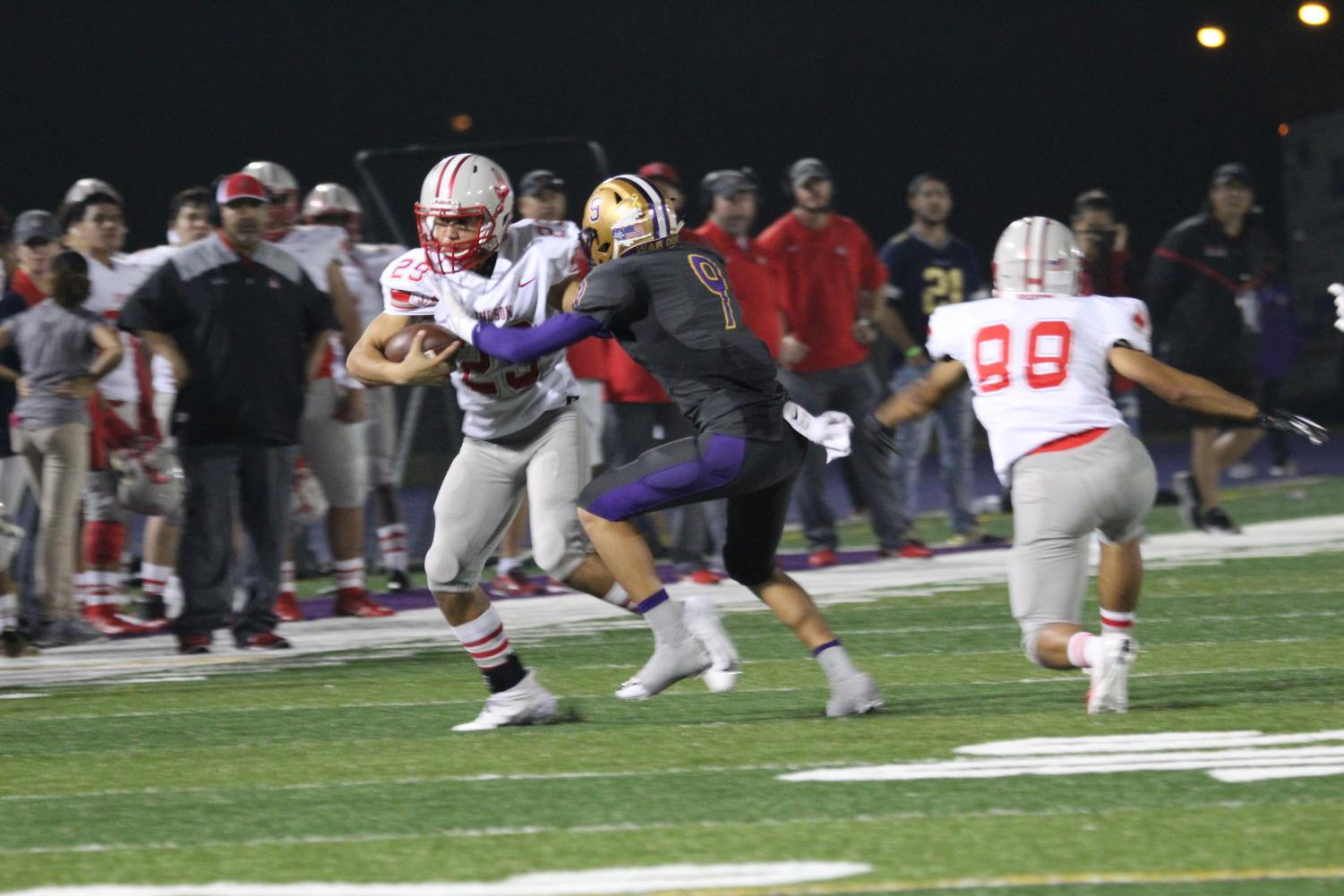 The Rocket receiver stiff arms San Benitos defender to create space. The Rockets ended the night with a score of 69-18.
