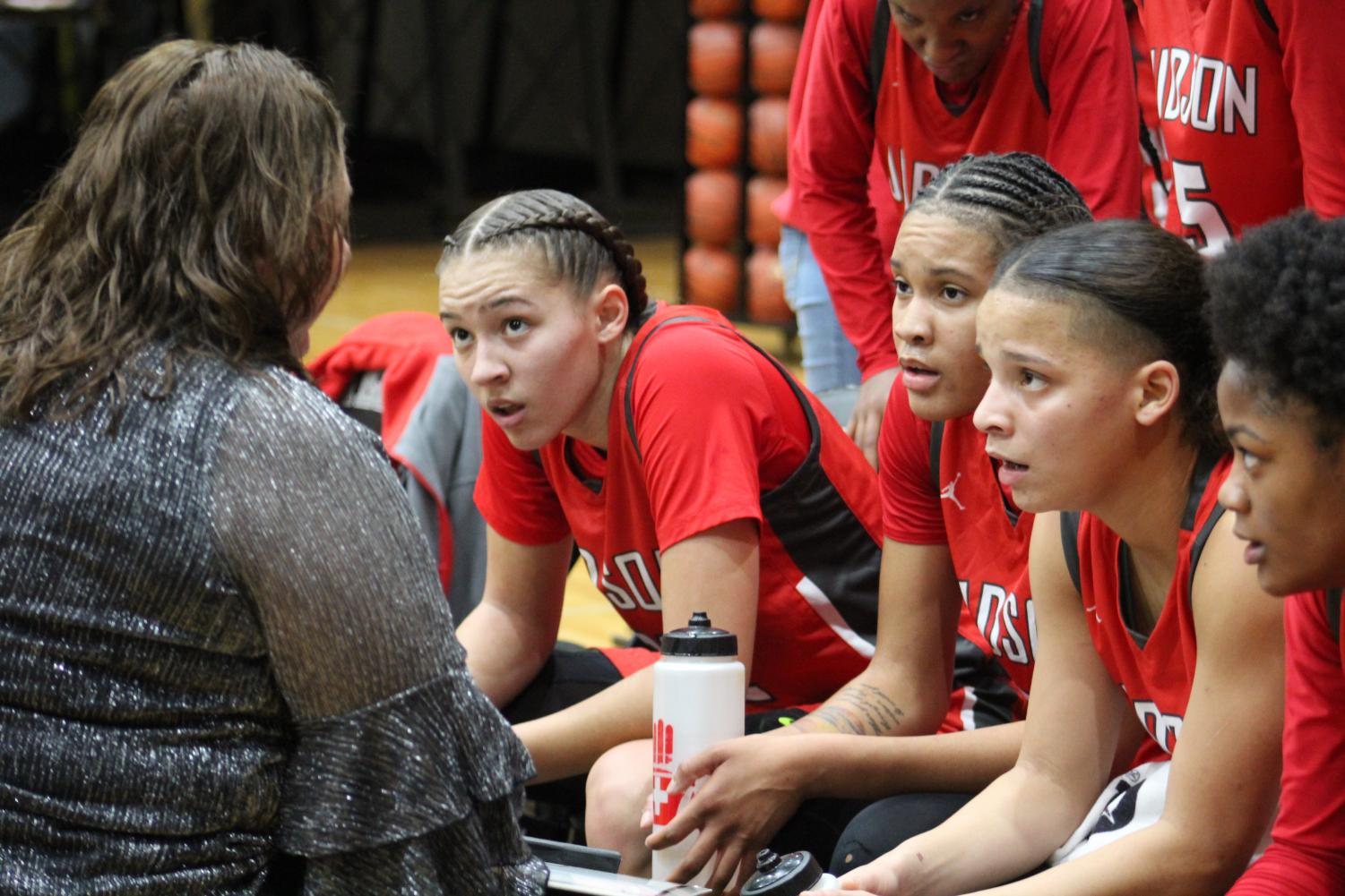 Coach Corrales instructs her starting five during a timeout. Rockets went on to win 63-46.