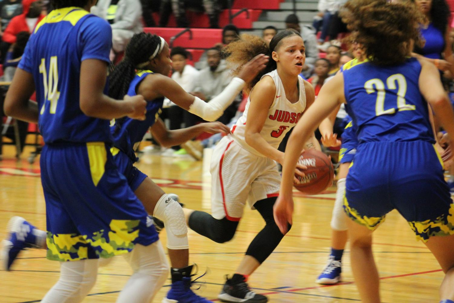 Senior Corina Carter drives past the Buffalo defense during a home district game. The Rockets blasted the Clemens Buffaloes, 85-41.