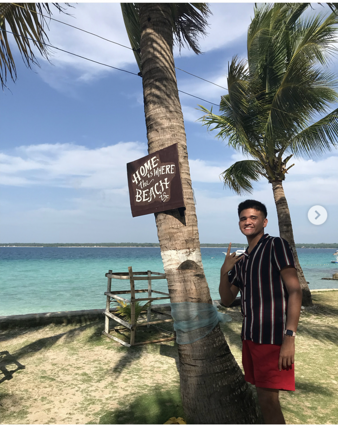 Senior JonPatrick poses in front of a palm tree at one of the few islands he visited back home during the summer. JohnPatrick moved from the Philippines to the states when he was younger and goes back during summer to see family and reconnect.