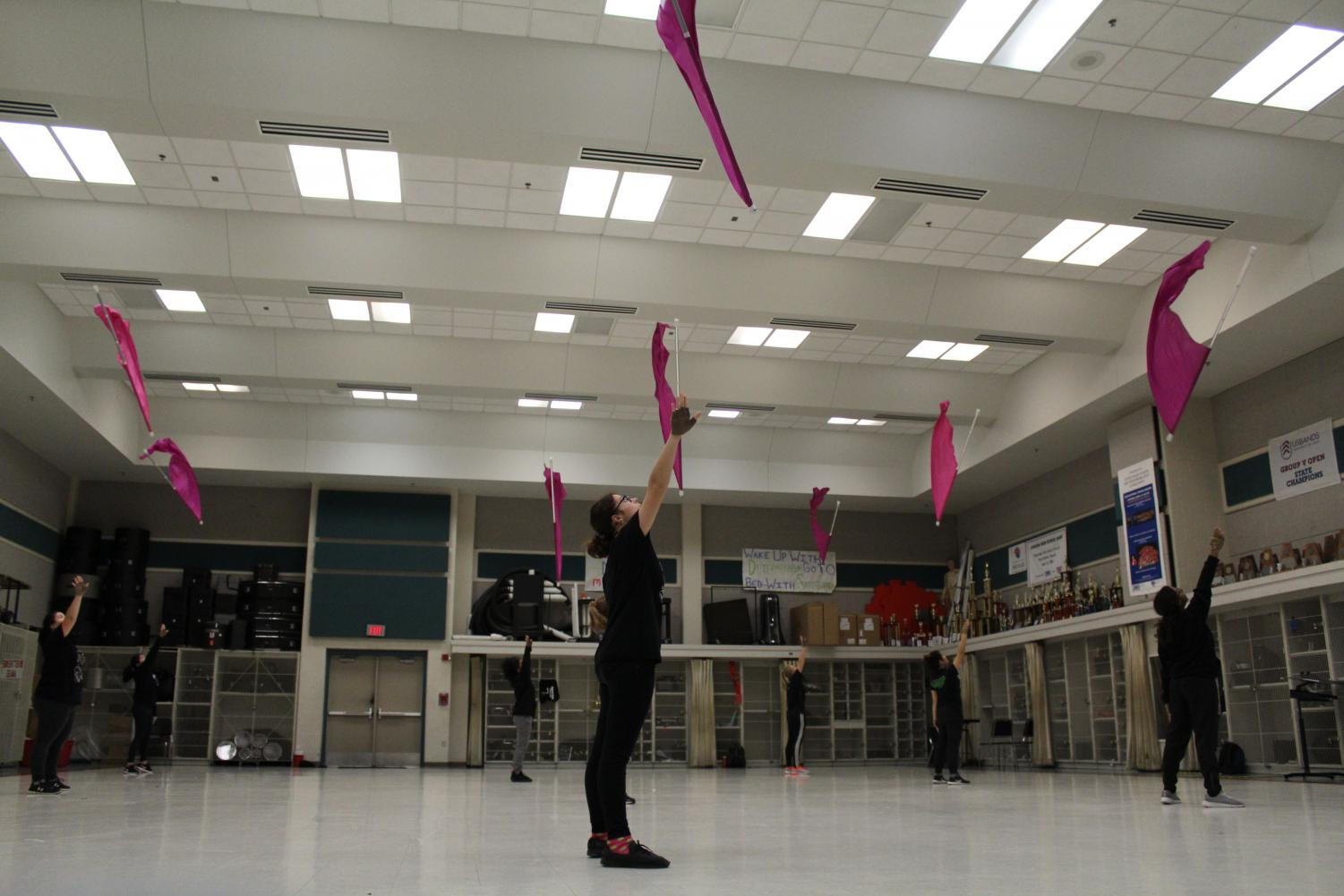 "Varsity color guard practices tosses together in class. The varsity team competed in the winter season the show ""Aretha Franklin: Queen Of Soul."""