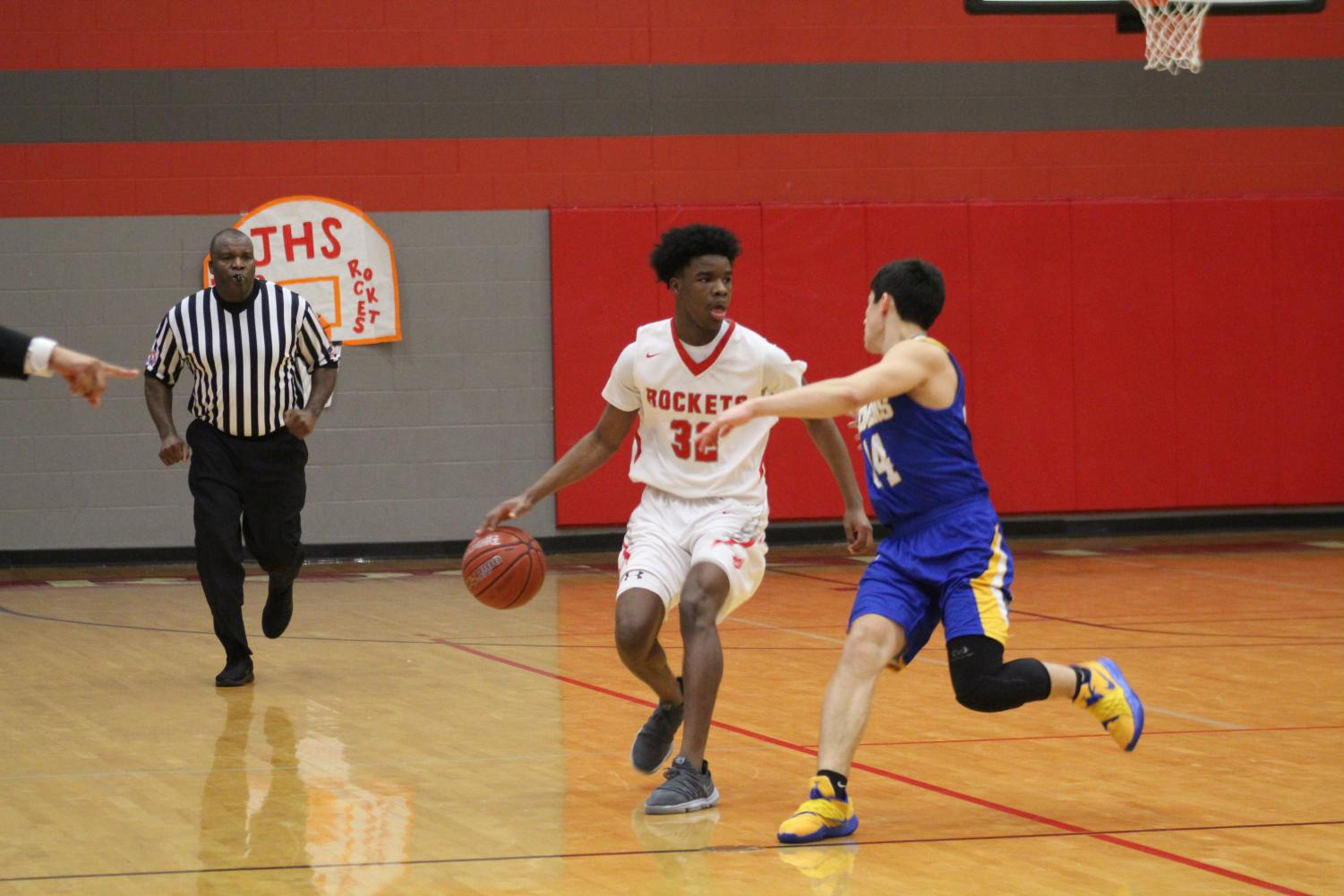 Senior Adrian Cohen brings the ball up to set up a play. The men lost to Clemens 73-80.