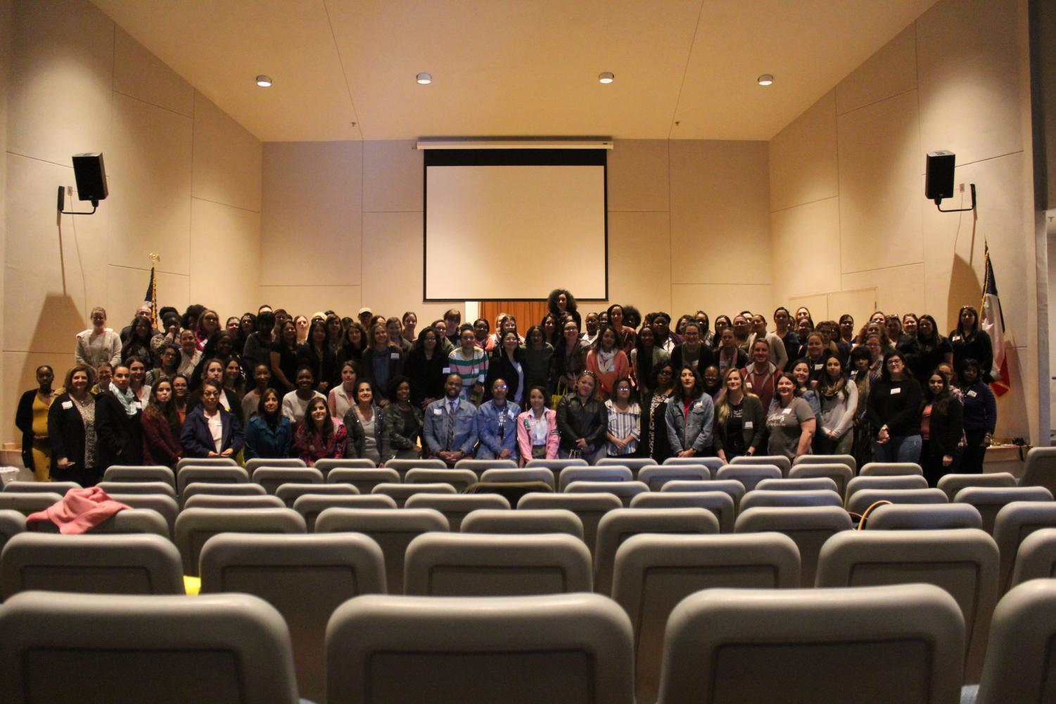 Teacher gather to take a group picture at the Teacher Self-Care Conference. Judson High School hosted teachers came from all over country on a workshop about teacher self-care.