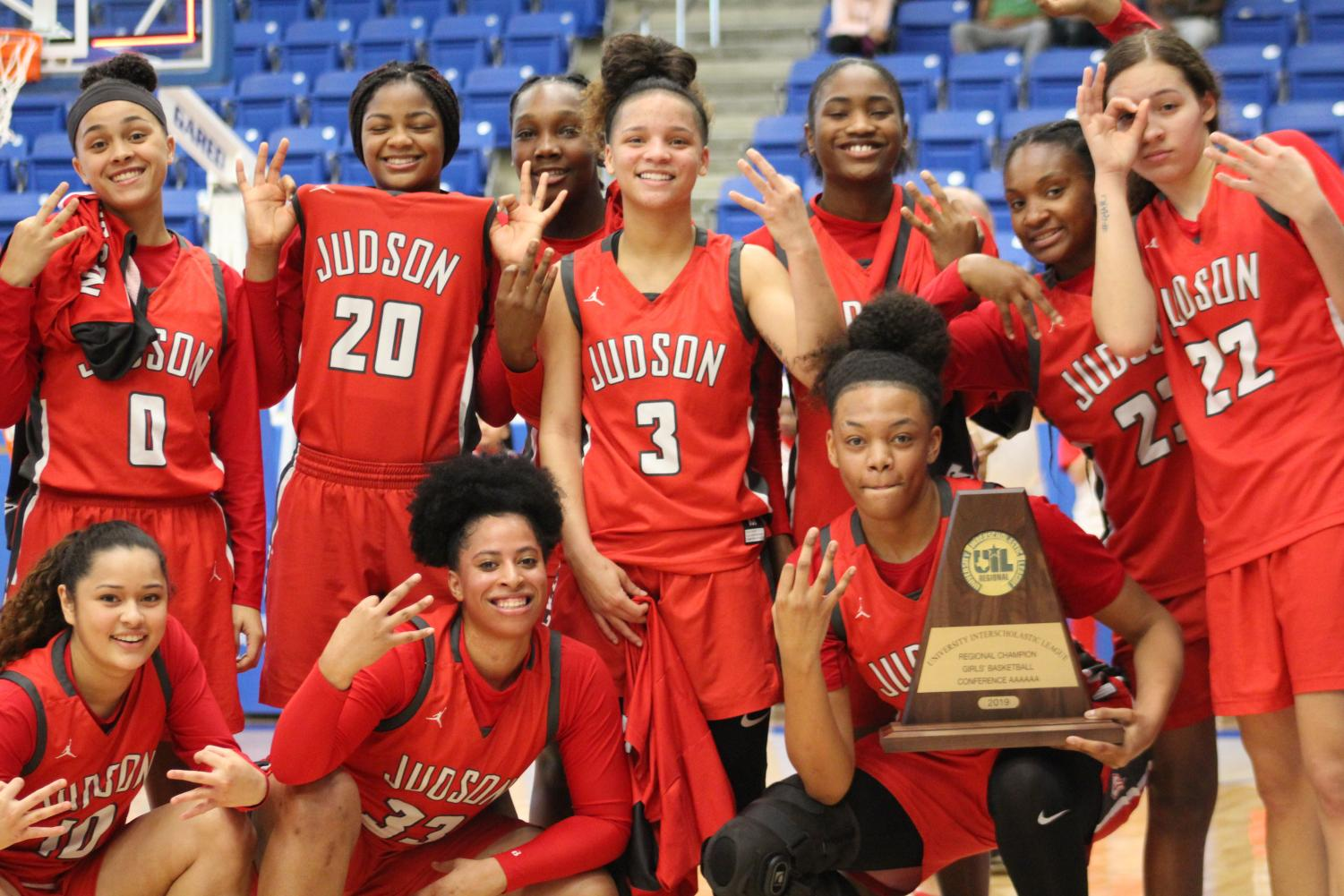 The Lady Rockets basketball team poses for the camera for their championship photo at Northside Sports Gym. The Lady Rockets beat Clark, 71-44, to advance to the State Tournament for the third consecutive season.
