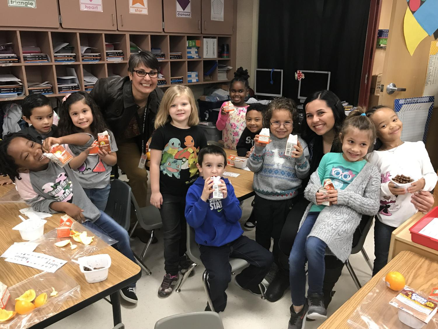 "During a nutritious breakfast, elementary students of JISD smile with their milk and breakfast foods. JISD implemented ""Breakfast in the Classroom"" at five elem. and at the JCARE."