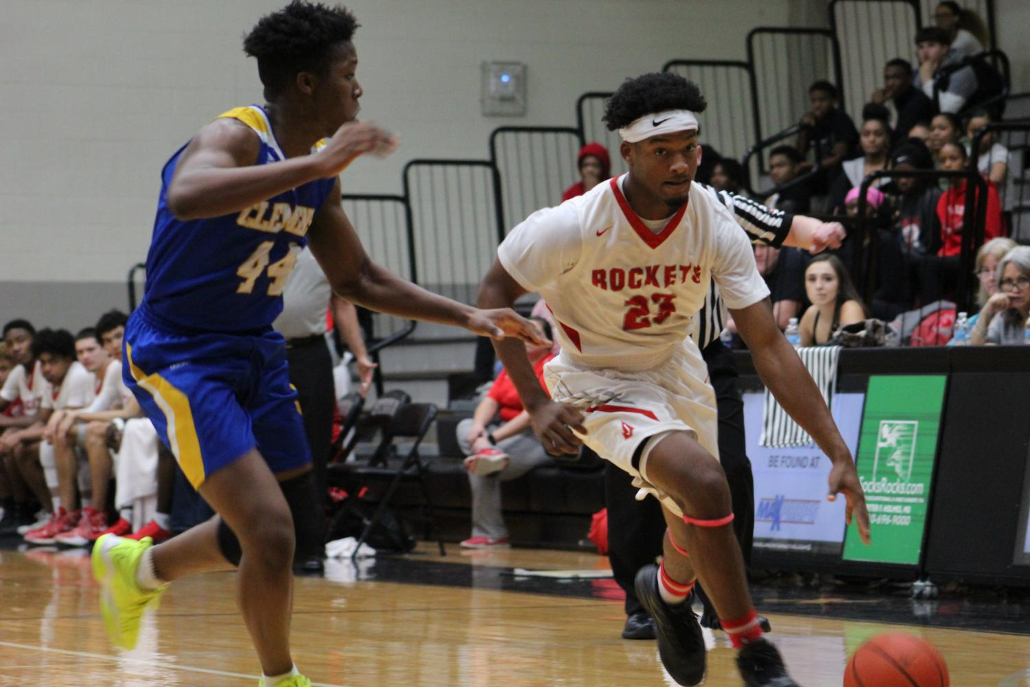 Junior Amarea Bailey-Davis dribbles th ball past the Clemens' defense. The Rockets placed second in the district after beating the Clemens Buffaloes, 72-68.