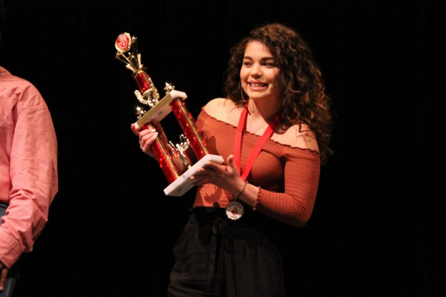 Senior Jeselle Aguilar holds the trophy for winning first place in the Rocket Talent Show at the Performing Arts Center. Aguilar competed against ten other students.