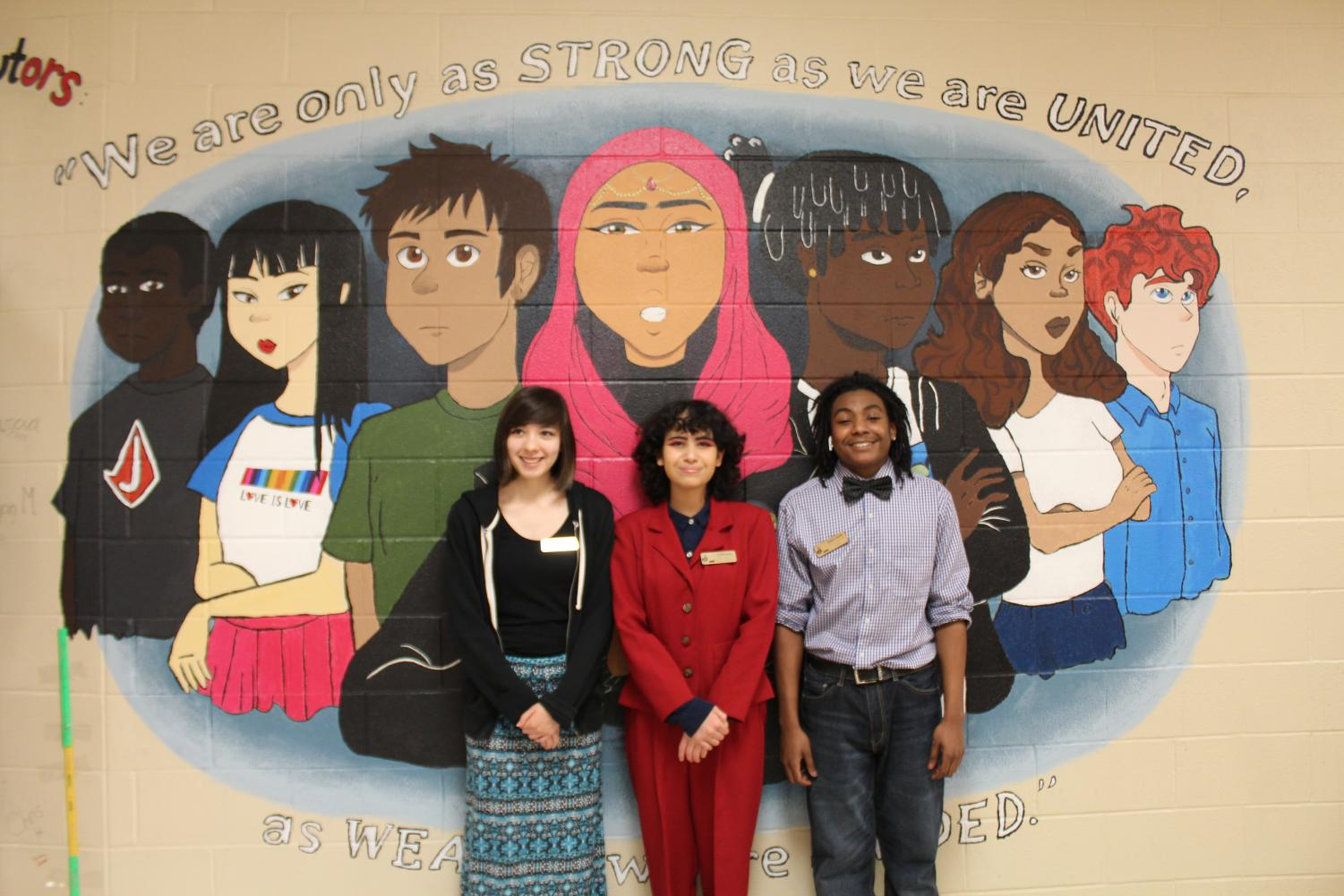 The animation team stands in front to their proud masterpiece which represents unity. The mural is painted on the side of the F wing upstairs.