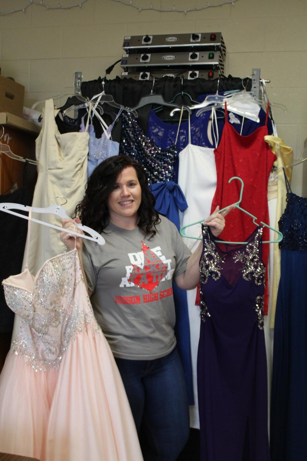 Ms. Brianna Merchant is posed in front of the many dresses and formal wear she has gotten donated by students on campus. Merchant revamps 'Cinderella's closet' into 'A Royal fit' for students to be able to donate their used formal wear for other to be able to have and go to these events.