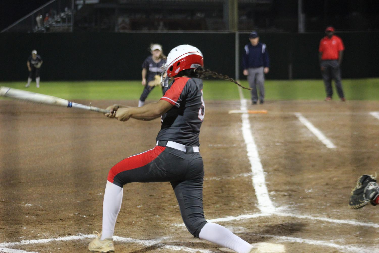 Senior Nyah Chapa crushes a deep double. Softball beat San Marcos 11-1.
