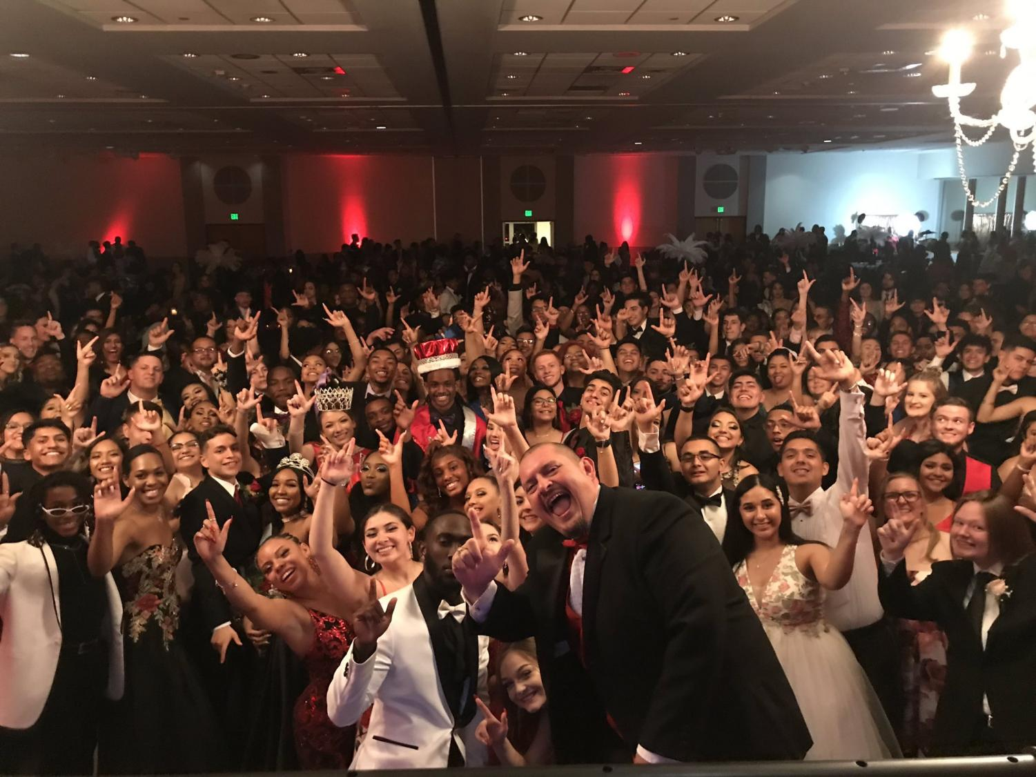 Mr. Hernandez takes a picture with the entire Prom crowd behind him. The event was held in the Rosenberg Skyroom at the University of the Incarnate Word.