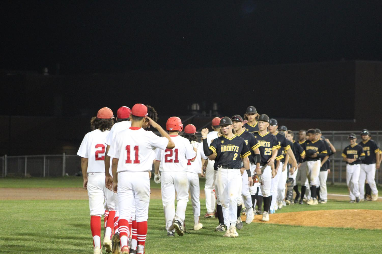 The baseball team high fives East Central after their lost. After this game, they have two more away games for the season.