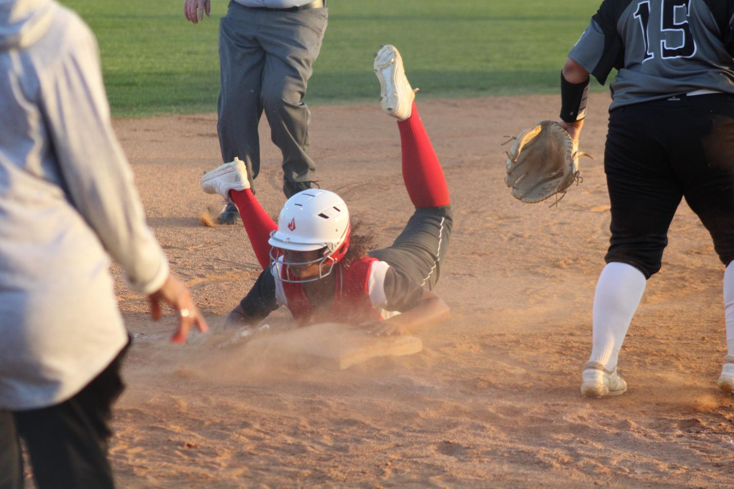 Freshman Keely Williams slides into third base. The Rockets are on a roll, with San Marcos coming up next this Friday.