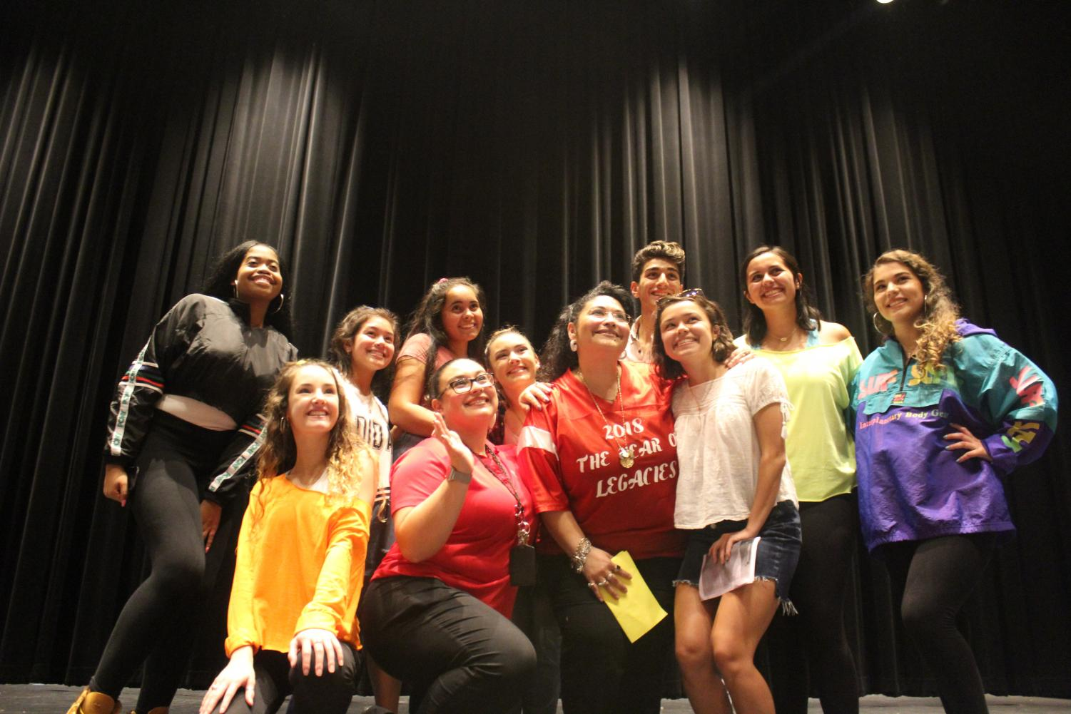 Senior and junior class officers get together for a group picture during the annual Lip Sync Battle. The groups are joining, along with Student Council officers, to create one group.