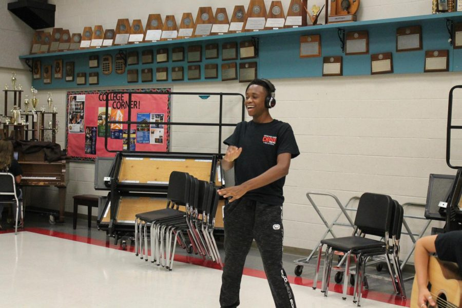 Sophomore Edwin Howell dances in the choir hall while planning for the officer retreat. He is involved in numerous organizations, including swim and track.