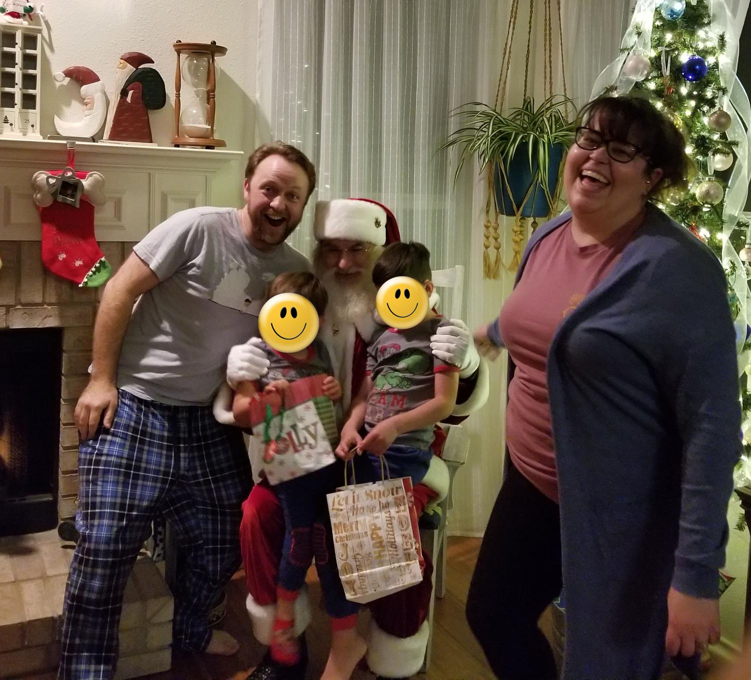The Lowrey family takes a picture during Christmas with Santa. Out of respect for the family, the identity of the children were kept private.