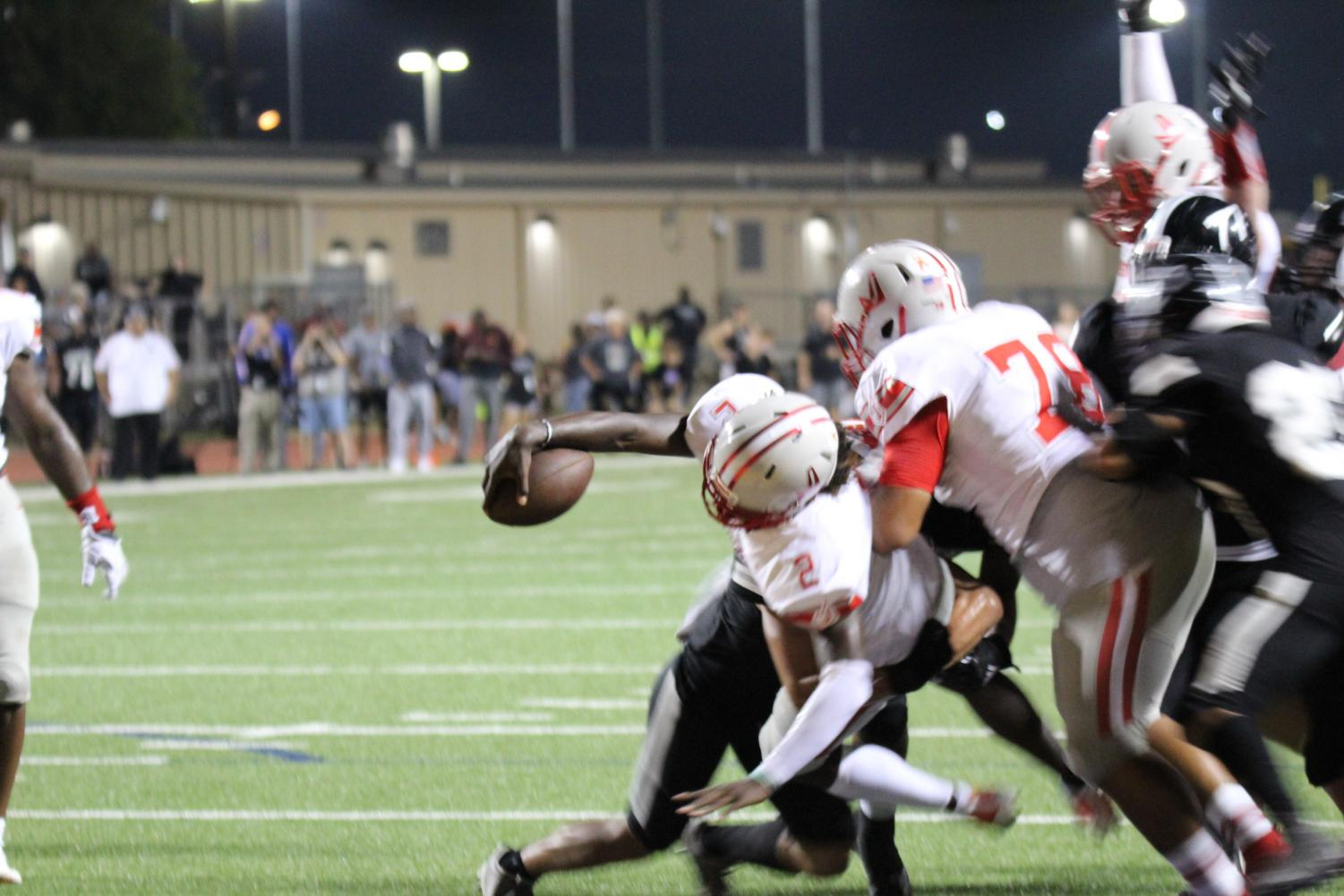 Senior Mike Chandler runs into the end zone to make the game winning touchdown. The Rockets won 51-48.