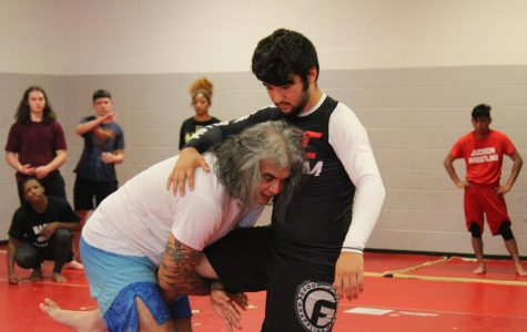 Mr. Victor Santos teachers a student how to grapple. This is the first year for the ju-jitsu club on campus.