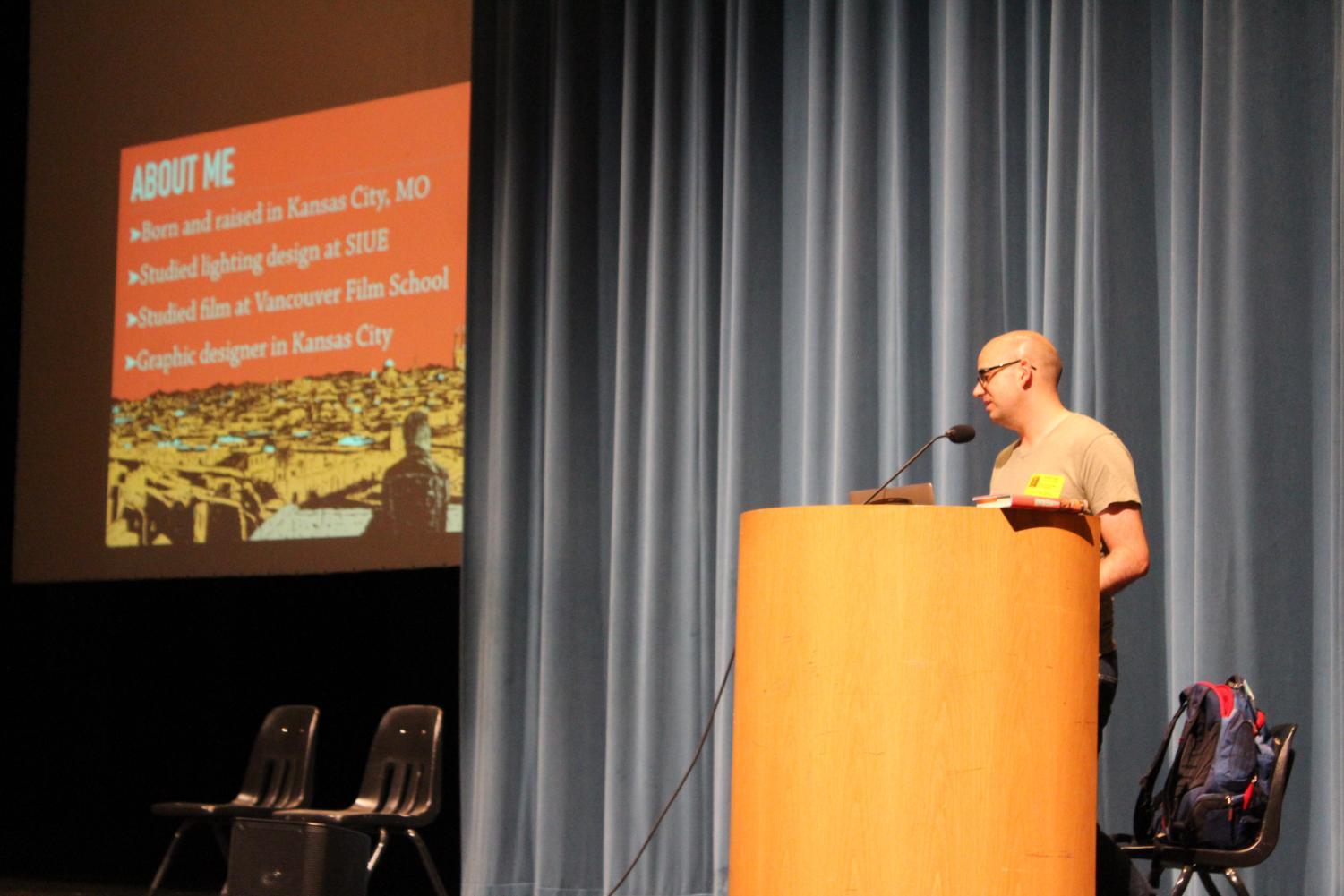 """Author Adib Khorram speaks in front of a group of students in the Performing Arts Center. He spoke about his life and inspiration behind his first published novel """"Darius The Great Is Not Okay."""""""