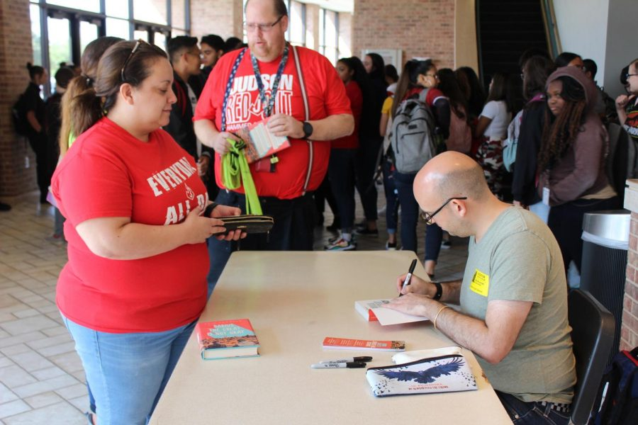 After his presentation, Adib Khorram signed books for students and staff members.